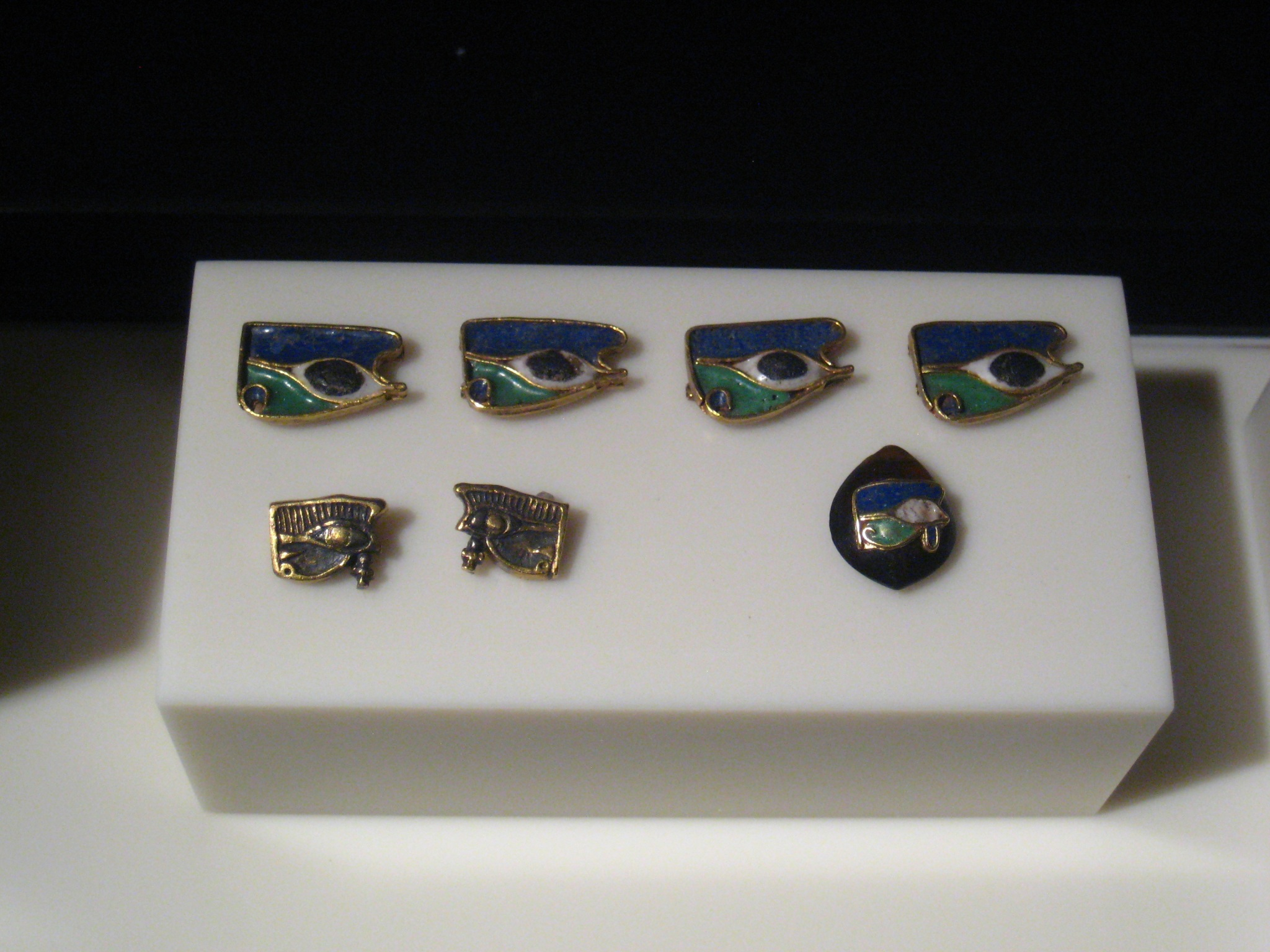 Wadjet eye charms from a bracelet found in Queen Amanishakheto's pyramid