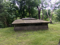 Only the mausoleum's roof is visible from the main path