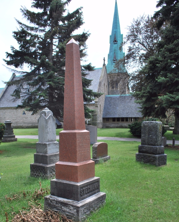 An obelisk at St. James Cemetery with the chapel of St. James-The-Less in the background (authors' photo)